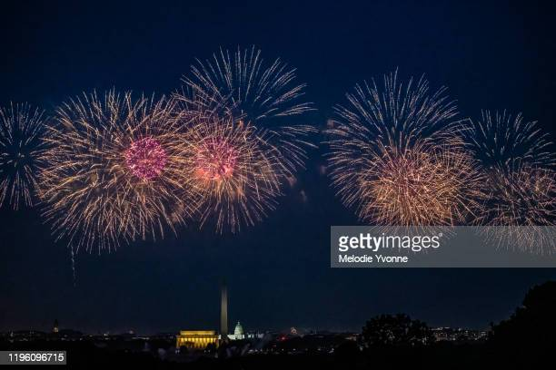 horizontal color image of view from arlington ridge park of white house and memorials in washington dc surrounded by fireworks - national holiday stock pictures, royalty-free photos & images