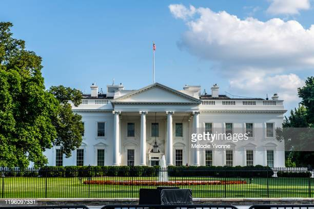 horizontal color photo of white house in washington dc on a bright summer day - president stock pictures, royalty-free photos & images