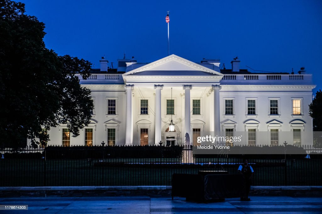 Horizontal color photo of White House in Washington DC on a clear summer evening : Stock Photo