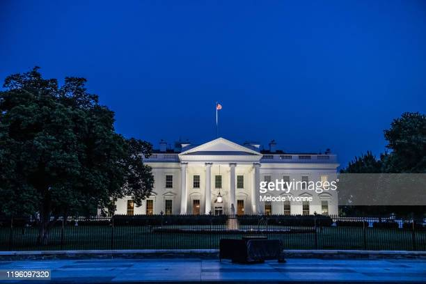 horizontal color photo of white house in washington dc on a clear summer evening - white house exterior stock pictures, royalty-free photos & images