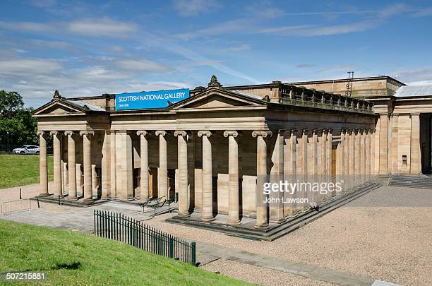 Horizontal image of the The Scottish National Gallery in Edinburgh, Scotland UK, set against a blue sky. This gallery is, as its name suggests, the...