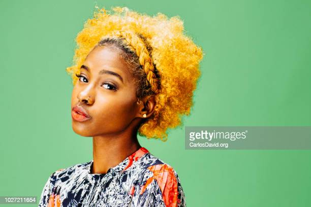 Horizontal portrait of a lovely young girl with bleached curly hair