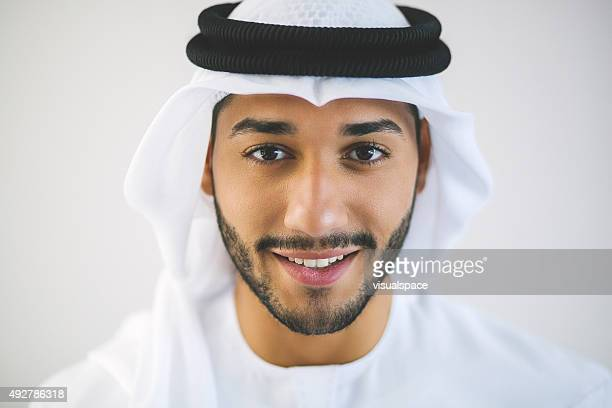 horizontal portrait of young smiling arab man - united arab emirates stock pictures, royalty-free photos & images