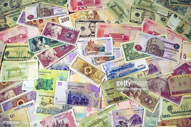 Horizontal shot of colorful banknotes in different denominations from around the world. Countries represented include the United States of America,...
