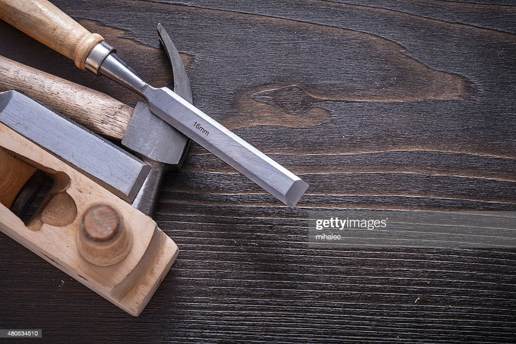 Horizontal version of claw hammer shaving plane and chisels on : Bildbanksbilder