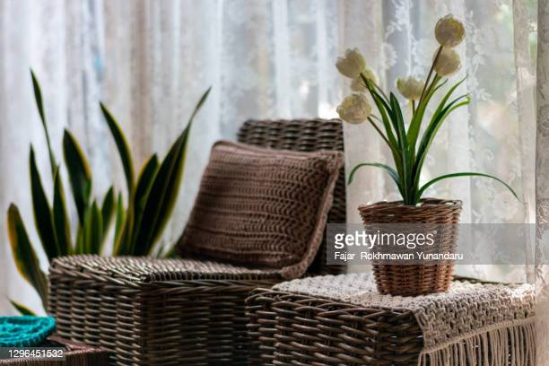 horizontal view living room with tables and chairs and pot decorations made of rattan - wicker stock pictures, royalty-free photos & images
