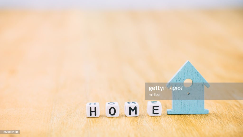 Home Horizontal Word Of Cube Letters Behind Blue House Symbol On