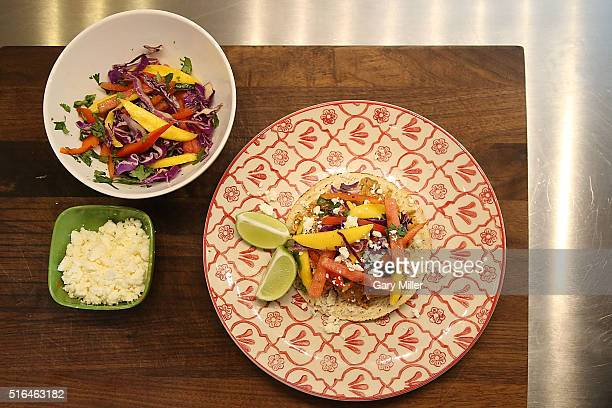 Hormel Taco Meat tacos being prepared at the GQ Jam In The Van Artist House sponsored by Hormel Taco Meats on March 18 2016 in Austin Texas