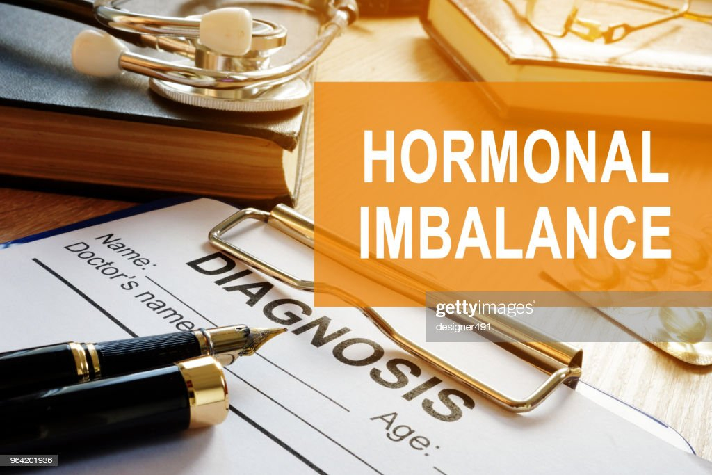 Hormonal imbalance concept. Medical documents on a desk. : Stock Photo