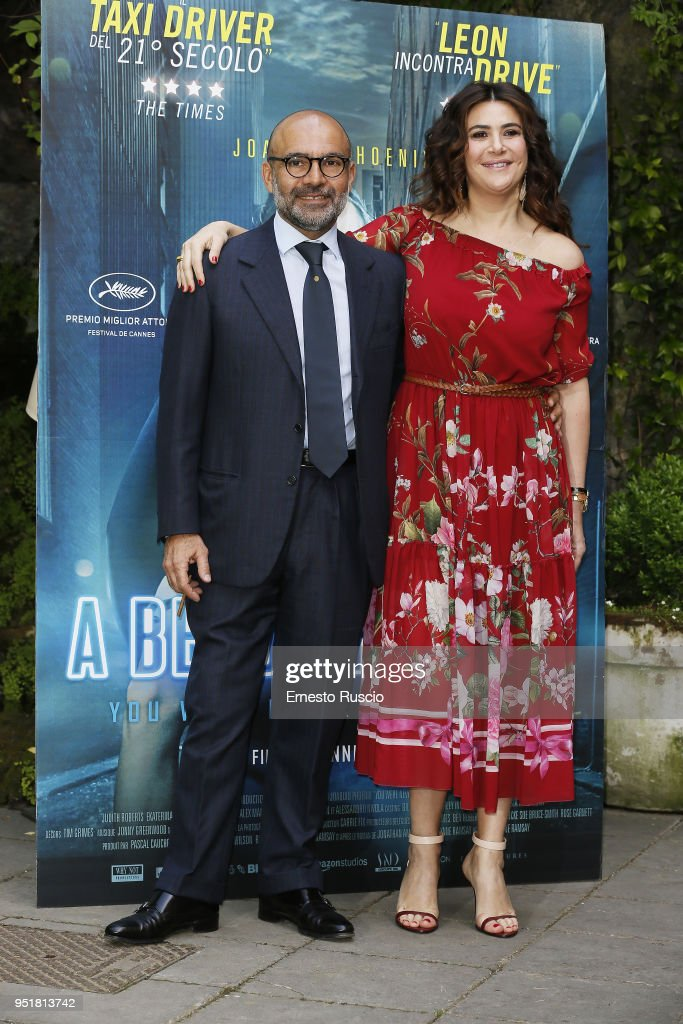Hormoz Vasfi and Lucy De Crescenzo attend 'A Beautiful Day' photocall at Hotel De Russie on April 27, 2018 in Rome, Italy.