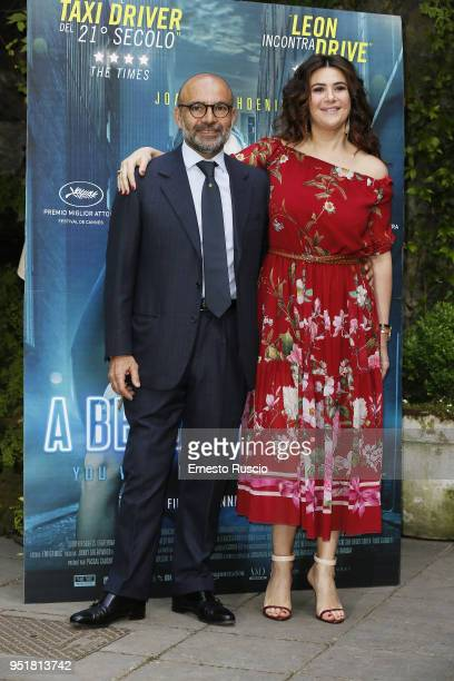 Hormoz Vasfi and Lucy De Crescenzo attend 'A Beautiful Day' photocall at Hotel De Russie on April 27 2018 in Rome Italy