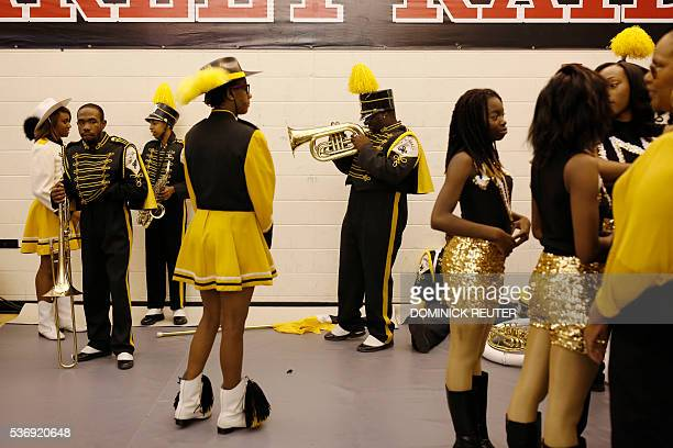 A horn player from the Malcom X Shabazz High School marching band warms up before Democratic presidential candidate Hillary Clinton speaks at a...
