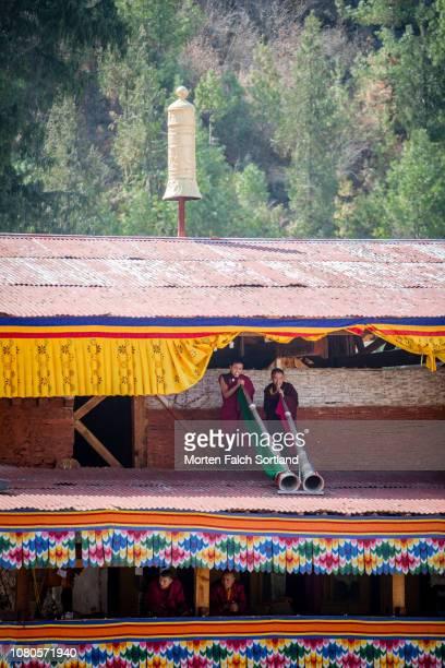 Horn Players at Paro Tsechu Festival at Rinpung Dzong Monastery in Paro, Bhutan Springtime