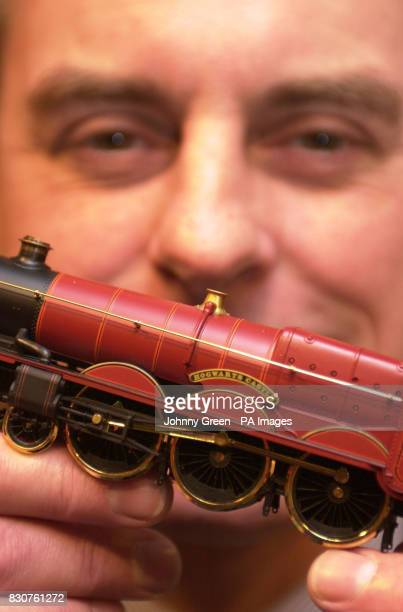 Hornby Chief Executive Frank Martin looks at a special edition Harry Potter Hogwart's Express train in Hamleys toyshop in London prior to the release...