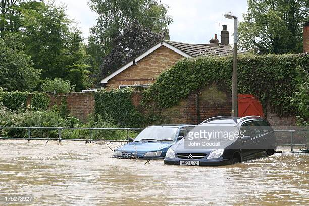 CONTENT] Horncastle Lincolnshire flooded in 2007 Cars submerged in flooded street