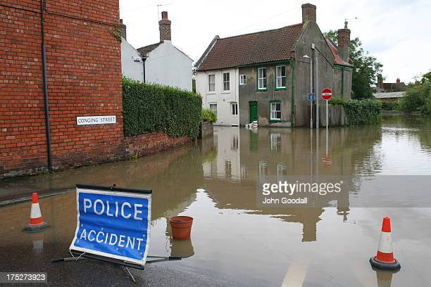 CONTENT] Horncastle Lincolnshire flooded in 2007 Police accident sign blocks the road to motorists