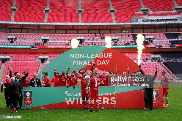Hornchurh players celebrate with the trophy after the Buildbase FA Trophy 2020/21 Final at Wembley Stadium, London. Picture date: Saturday May 22,...