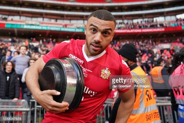 Hornchurh's Nathan Cooper celebrates with the trophy base after the Buildbase FA Trophy 2020/21 Final at Wembley Stadium, London. Picture date:...