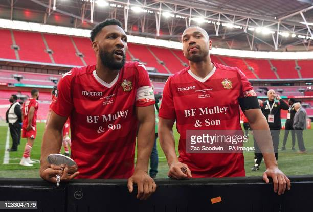 Hornchurh's Rickie Hayes and Lewwis Spence celebrate with the trophy lid after the Buildbase FA Trophy 2020/21 Final at Wembley Stadium, London....