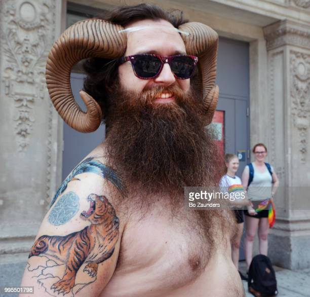 Horned, bearded, and tattooed participant in  annual Gay Pride Parade in NYC.