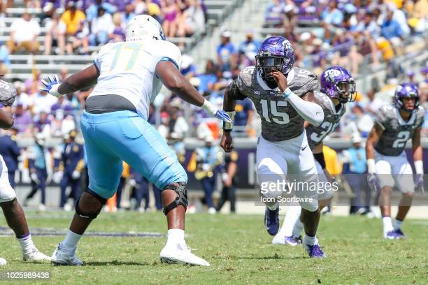 Horned Frogs defensive end Ben Banogu tries to get to the quarterback as Southern University Jaguars offensive lineman Jodeci Harris tries to block...