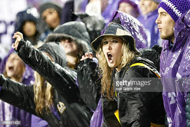 Horned Frogs fans wait during a lightning delay prior to the NCAA Big 12 football game between the TCU Horned Frogs and the Baylor Bears at Amon G...