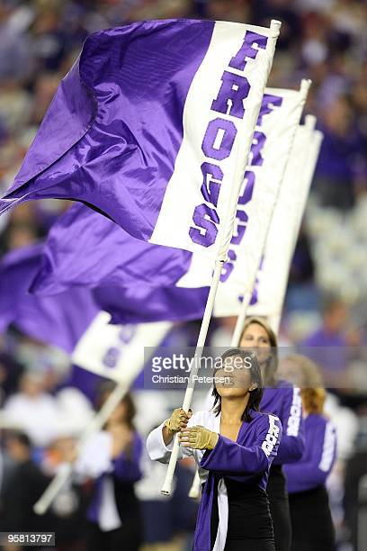 Horned Frogs flag team member looks up at her flag before the Horned Frogs take on the Boise State Broncos during the Tostitos Fiesta Bowl at the...