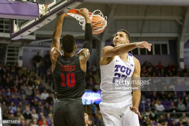 Horned Frogs forward Ahmed HamdyMohamed misses his attempt to block a dunk by Southern Methodist Mustangs guard Jarrey Foster during the game between...
