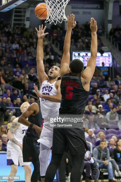 Horned Frogs forward Ahmed HamdyMohamed shoots over Southern Methodist Mustangs forward Ethan Chargois during the game between the SMU Mustangs and...