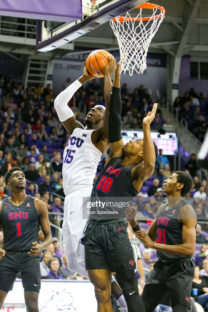 TCU Horned Frogs forward JD Miller (15) is defending by Southern Methodist Mustangs guard Jarrey Foster (10) during the game between the SMU Mustangs and TCU Horned Frogs on December 5, 2017 at Ed & Rae Schollmaier Arena in Fort Worth, TX.