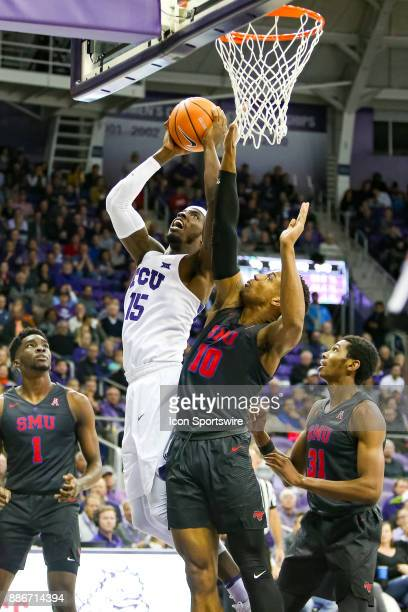 Horned Frogs forward JD Miller is defending by Southern Methodist Mustangs guard Jarrey Foster during the game between the SMU Mustangs and TCU...