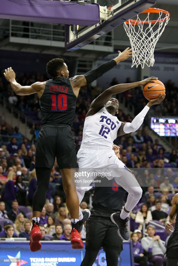 TCU Horned Frogs forward Kouat Noi (12) makes a move to the rim around Southern Methodist Mustangs guard Jarrey Foster (10) during the game between the SMU Mustangs and TCU Horned Frogs on December 5, 2017 at Ed & Rae Schollmaier Arena in Fort Worth, TX.