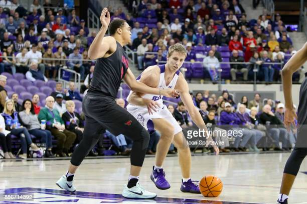 Horned Frogs forward Vladimir Brodziansky handles the ball with Southern Methodist Mustangs forward Ethan Chargois defending during the game between...