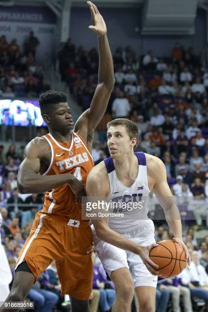 Horned Frogs forward Vladimir Brodziansky is guarded by Texas Longhorns forward Mohamed Bamba during the game between the Texas Longhorns and TCU...