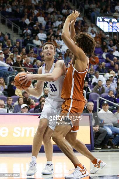 Horned Frogs forward Vladimir Brodziansky looks for a shot with Texas Longhorns forward Jericho Sims defending during the game between the Texas...