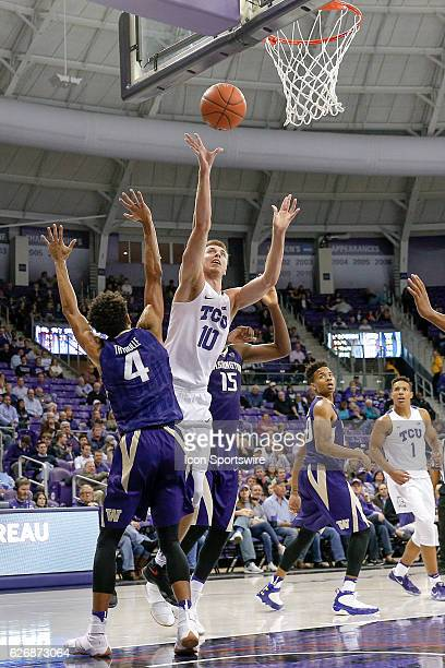 Horned Frogs forward Vladimir Brodziansky scores after splitting the defense of Washington Huskies forward Noah Dickerson and forward Matisse...