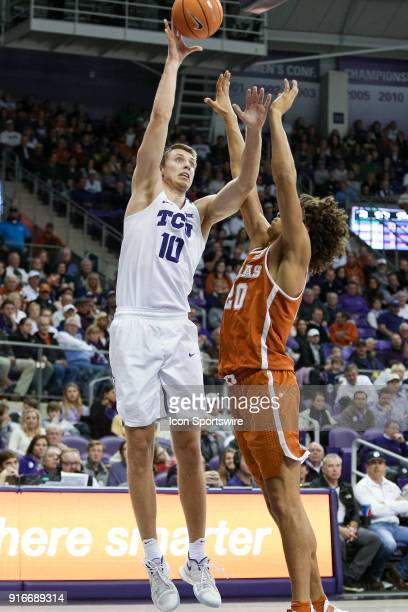 Horned Frogs forward Vladimir Brodziansky shoots over Texas Longhorns forward Jericho Sims during the game between the Texas Longhorns and TCU Horned...