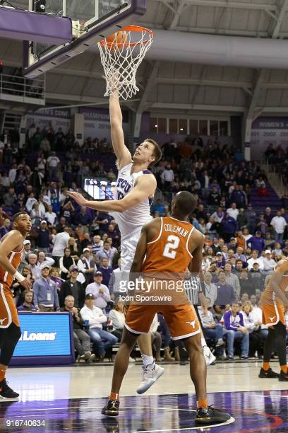 Horned Frogs forward Vladimir Brodziansky stretches for a shot over Texas Longhorns guard Matt Coleman during the game between the Texas Longhorns...