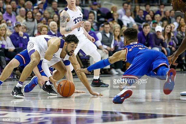 Horned Frogs guard Alex Robinson and Kansas Jayhawks guard Frank Mason III scramble for a loose ball during the NCAA Big12 game between the Kansas...