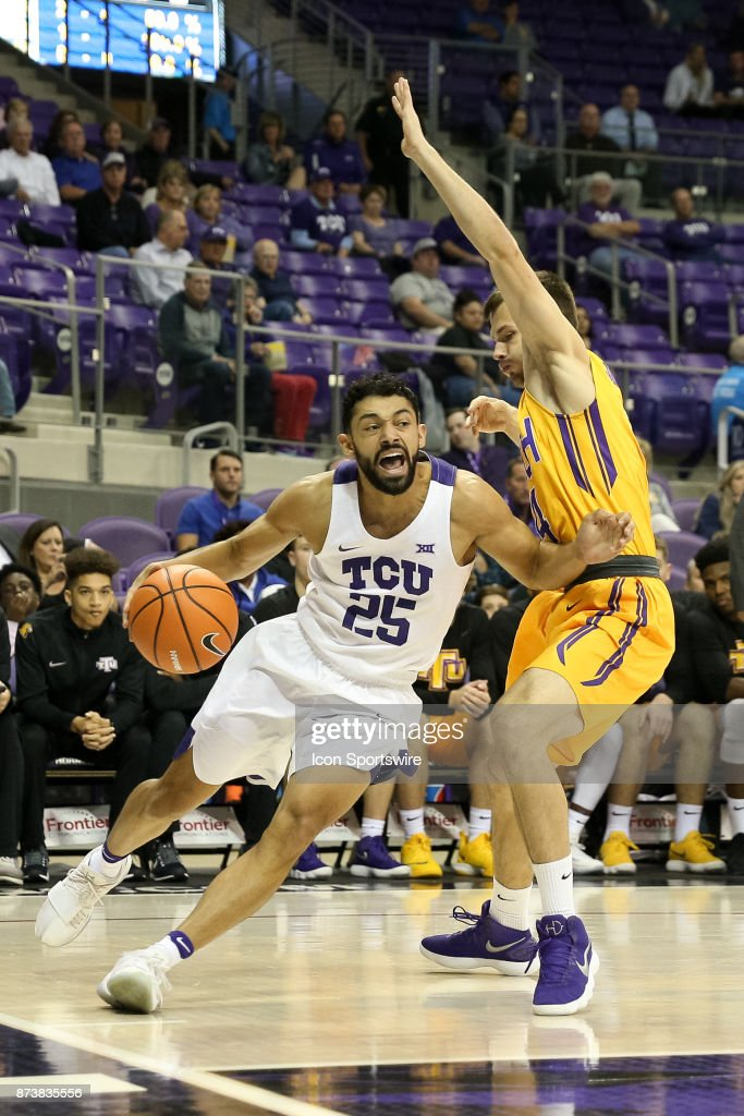 TCU Horned Frogs guard Alex Robinson (25) drives the baseline against Tennessee Tech Golden Eagles guard Aleksa Jugovic (4) during the game between the Tennessee Tech Golden Eagles and TCU Horned Frogs on November 13, 2017 at Ed & Rae Schollmaier Arena in Fort Worth, TX.