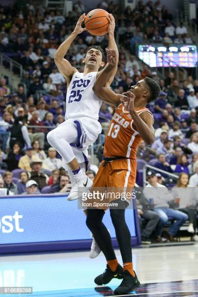 Horned Frogs guard Alex Robinson drives to the basket around Texas Longhorns guard Jase Febres during the game between the Texas Longhorns and TCU...