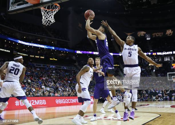 Horned Frogs guard Alex Robinson gets past Kansas State Wildcats guard Barry Brown for an easy basket in the second half of a quarterfinal game in...