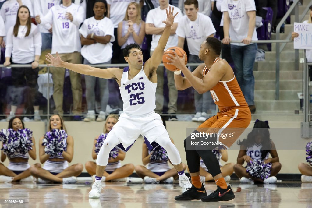 TCU Horned Frogs guard Alex Robinson (25) guards Texas Longhorns guard Eric Davis Jr. (10) during the game between the Texas Longhorns and TCU Horned Frogs on February 10, 2018 at Ed & Rae Schollmaier Arena in Fort Worth, TX.
