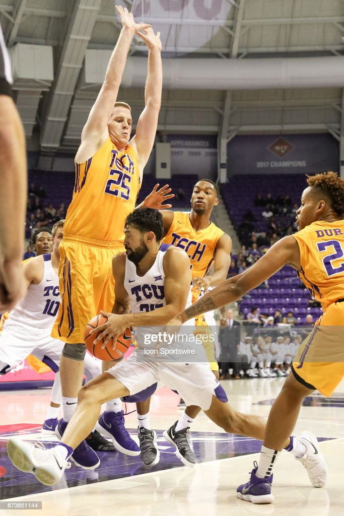 TCU Horned Frogs guard Alex Robinson (25) is defended by Tennessee Tech Golden Eagles forward Mason Ramsey (25) during the game between the Tennessee Tech Golden Eagles and TCU Horned Frogs on November 13, 2017 at Ed & Rae Schollmaier Arena in Fort Worth, TX.
