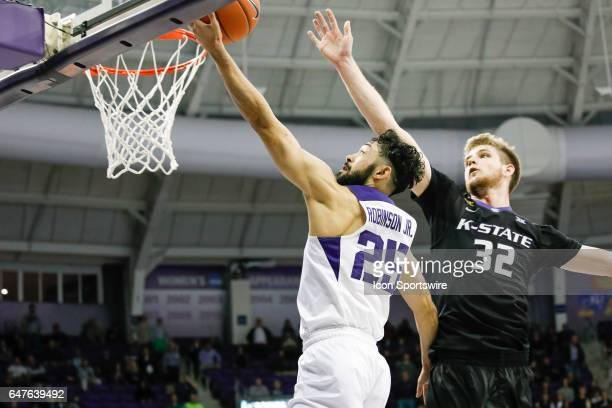 Horned Frogs guard Alex Robinson lays the ball up as he is challenged by Kansas State Wildcats forward Dean Wade during the basketball game between...