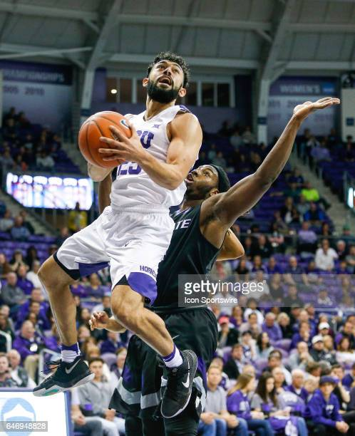 Horned Frogs guard Alex Robinson leaps for a shot under the basket during the basketball game between Kansas State Wildcats and TCU Horned Frogs on...