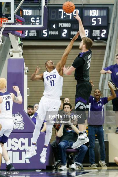 Horned Frogs guard Brandon Parrish challenges a shot by Kansas State Wildcats forward Dean Wade during the basketball game between Kansas State...