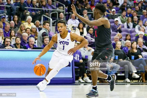 Horned Frogs guard Desmond Bane drives on Southern Methodist Mustangs guard Shake Milton during the game between the SMU Mustangs and TCU Horned...