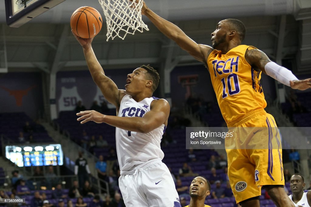 TCU Horned Frogs guard Desmond Bane (1) goes to the basket with Tennessee Tech Golden Eagles guard Kajon Mack (10) defending during the game between the Tennessee Tech Golden Eagles and TCU Horned Frogs on November 13, 2017 at Ed & Rae Schollmaier Arena in Fort Worth, TX.