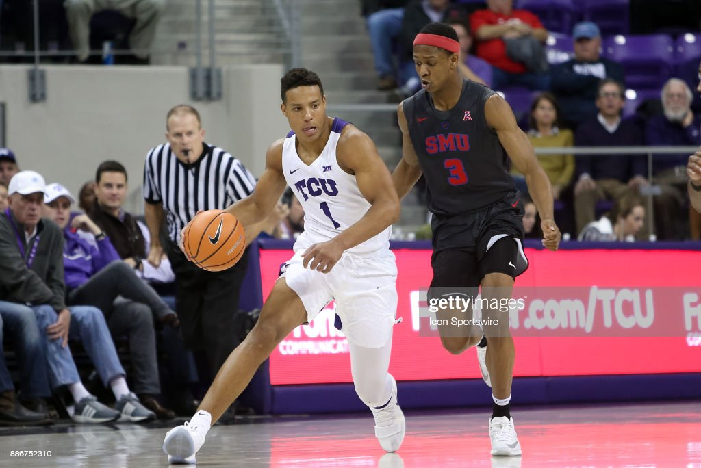 TCU Horned Frogs guard Desmond Bane (1) is trailed by Southern Methodist Mustangs guard William Douglas (3) during the game between the SMU Mustangs and TCU Horned Frogs on December 5, 2017 at Ed & Rae Schollmaier Arena in Fort Worth, TX.